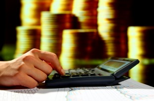 businessman calculate of incomes finance concept