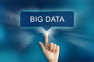 hand pushing on big data balloon text button